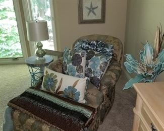 Chair with ottoman, pillows