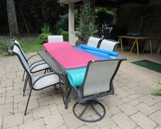Patio table with 6 chairs and 2 rockers