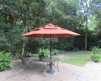 Sunbrella vented umbrella with auto tilt 11 foot with 50 lb. stand and extra  30 lb. weight.  Hand crank.