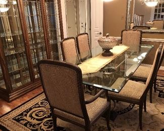 Large and heavy formal dining table with 8 chairs.  Large glass china cabinet.   Mint condition.