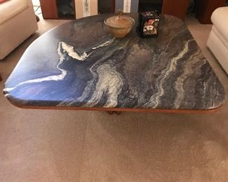 Stone top coffee table with teakwood base