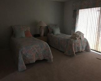 Two of 4 twin beds