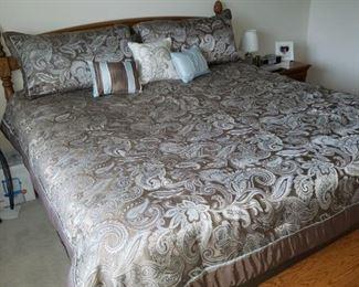 King bed frame, headboard, bedding, bench, framed art