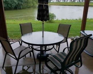 Outdoor table, chairs and umbrella