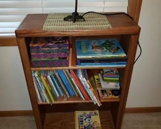 Wood book shelf, desk lamp, books