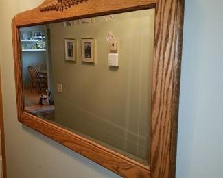 Beveled glass mirror in wood frame