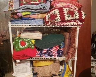 Blankets,  Afghans, wire shelf unit