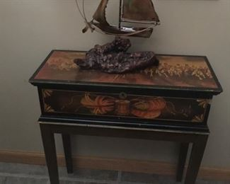 Antique table with lock and key.  British battle scene  two small oil paintings of cabin in the woods,  Copper sailboat sculpture