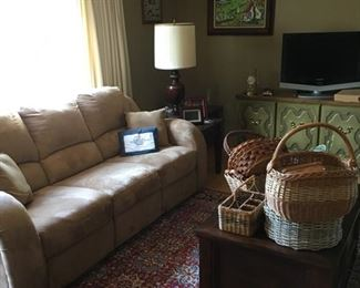 sofa, couch with recliner, microfiber fabric, wool oriental rug with leather edging underneath, wood coffee table with storage, antique lamp