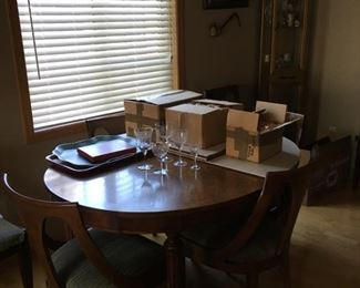 Tindale dining room table with 2 leaves, 6 mid-century modern chairs, table top pads, lead crystal set with flowers 36 pieces, vintage crystal set water/wine 22 pieces, curio cabinet with overhead light