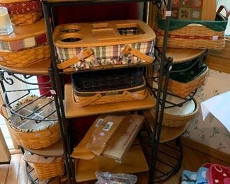 Longaberger wrought iron stands, wood shelves and Longaberger baskets. Large assortment of liners, extra protectors and lids