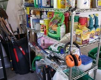 Lots of Garden Tools and Amendments, etc. Metal Shelving.