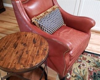 Leather Club Chair. Rustic Side Table. Large Wool Designer Carpet