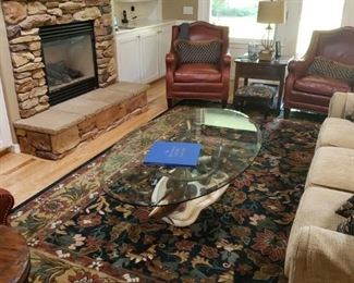 Beautiful Wool Carpet. Designer/Artist Glass and Fish Table. Leather Chairs. Sofa and more wonderful items.