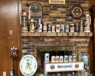 Vintage beer steins and beer sign