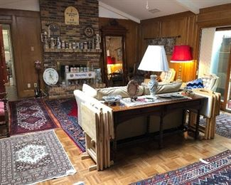 Persian Hand made rugs, sleeper sofa, sofa table, wood TV tray sets, vintage lamps.