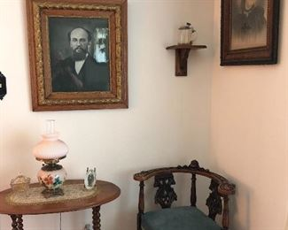 Antique photos and frames, 1800's corner chair, gone with the wind lamps, antique side table with turned legs.