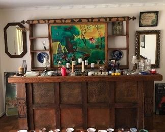 Hammered copper and barn wood bar with owl carvings. Antique mirrors and frames, Snow White and the seven dwarfs shelf with carvings from barn wood.