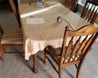 Dining table with 6 chairs and one leaf