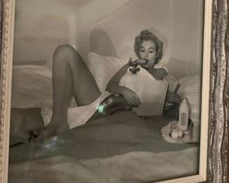 "BLACK AND WHITE PHOTOGRAPH, BY ANDRE DE DIENESS OF MARILYN MONROE, ""Breakfast in Bed"", 1953. Gelatin Silver Print . Vintage.SW32232 cm, full length, right knee up, with carrot in mouth looking at paper"