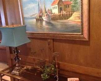 Another sofa table and framed art
