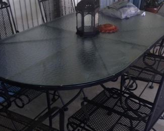 Oval patio table; spring chairs