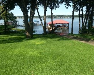 The beautiful lawn leads to the boathouse and lake.