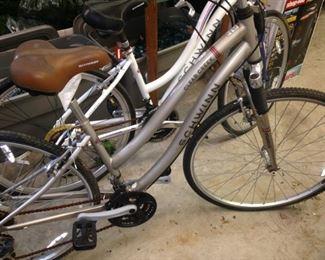 "White ""Trailway"" Schwinn bike and silver ""Clear Creek"" Schwinn bike"
