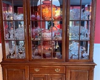 Beautiful china cabinet with mirrored back silver drawer.
