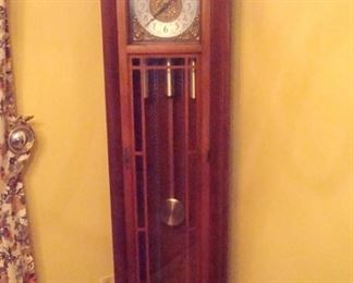 Colonial grandfather clock. good running condition.