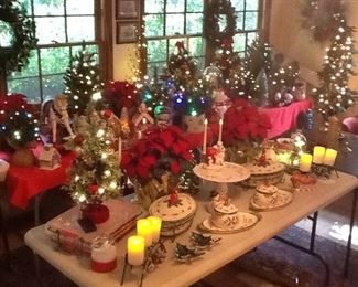 All sorts and sizes of lighted trees,candles, lighted wreaths, Temptations red Cardinal ovenware