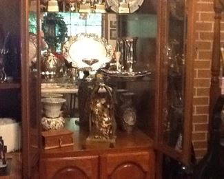 Three piece entertainment set fill with silver plate items, a music box and nativity.