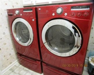 LG - Front in Loader, Washer/Dryer, Cranberry Color... Like NEW... Only use by 1 person......this includes stg. drawer below.... $ 600.   each.... Be the 1st...GREAT Buy.....