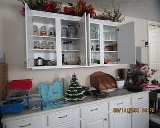 Garage blt in cabinet full of great finds.. holiday items, etc. appliances, etc..