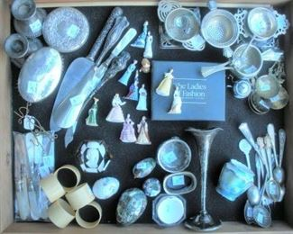 Sterling, silverplate and fine porcelain....multiple showcase with similar items at the tables with the jewelry cases.