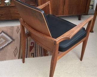 backside of teak desk chair – $165