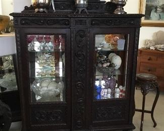 outstanding Brazilian carved hacienda style lighted china/curio cabinet– beautiful Brazilian exotic walnut– $395