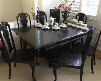 heavily carved beautiful Brazilian walnut vintage dining table set in excellent original condition. Set includes eight chairs ( two armchairs +6 side chairs) and two leaves– all chairs heavily carved Brazilian walnut with embossed leather insert seats – price $395