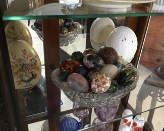 carved ostrich egg back right $90, egg shaped figurine hand-painted back left side $22 and mixed media and natural stone egg collection $8 to $18 each.