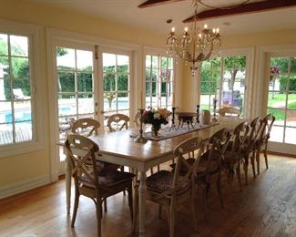 Country style designer dining table and chairs... breaks down easily to make a smaller table