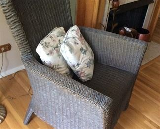 Crate and Barrel wicker chair with a matching foot stool