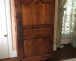 Early 19 c. Mahogany wardrobe with French and Asian accents.