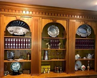 There are several built in shelves to Harold various collections.   In this photo: Arthur Court aluminum, leather bound National Geographic magazines, brass and porcelain
