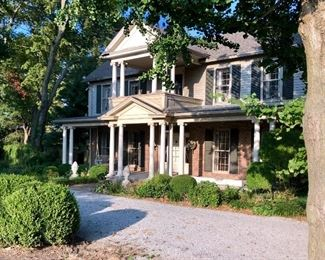 This sale is located in this 5000 square foot stately home with guest house, formal gardens and garage.