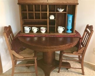 Antique round oak table, 3 antique chairs, top of postal cabinet w/ fold up top