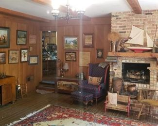 Selection of antique lithographs, samplers, hooked art, painted chest, wing chair, windsor chair, and child's rush bench, copper vessels, ship model, hanging cabinet, and more