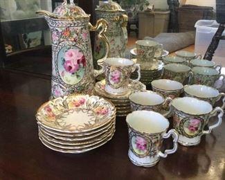 Vintage Porcelain Chocolate Pot, Bowls, and Cups for Six https://ctbids.com/#!/description/share/229576