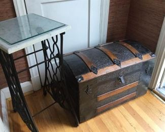 Marble plant stand and antique trunk. https://ctbids.com/#!/description/share/230644