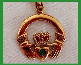Close up of 14CT Gold Claddagh Pendant