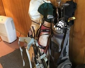3 Sets of Golf Clubs and a Cart